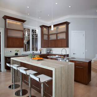 Design ideas for a contemporary kitchen in San Francisco with an integrated sink, flat-panel cabinets and dark wood cabinets.
