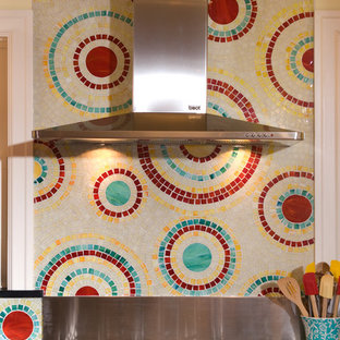 Inspiration for a contemporary kitchen in Seattle with red cabinets, multi-coloured splashback, mosaic tile splashback and stainless steel appliances.