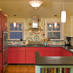 Kitchen - contemporary u-shaped kitchen idea in Seattle with an undermount sink, recessed-panel cabinets, red cabinets, multicolored backsplash, mosaic tile backsplash and stainless steel appliances