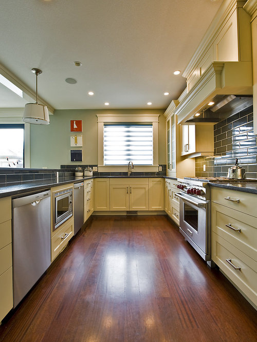 Marvelous Contemporary Kitchen Idea In Vancouver With Stainless Steel Appliances,  Recessed Panel Cabinets, Yellow Ideas