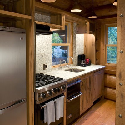 Mountain style single-wall enclosed kitchen photo in Minneapolis with a single-bowl sink and stainless steel appliances