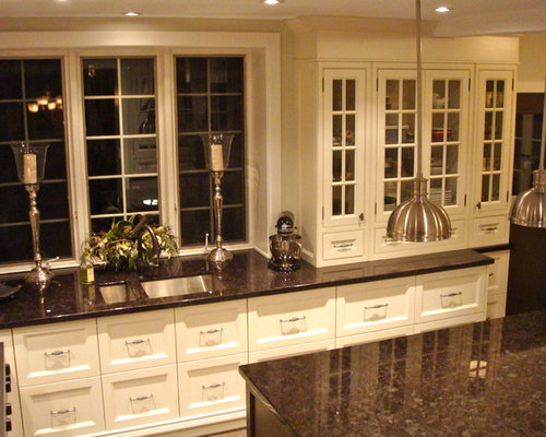 Dark brown granite houzz for Brown kitchen cabinets with black granite
