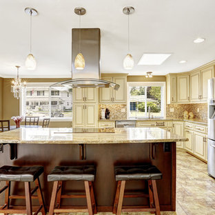 Photo of a large traditional galley eat-in kitchen in Salt Lake City with an undermount sink, louvered cabinets, white cabinets, granite benchtops, glass tile splashback, stainless steel appliances, ceramic floors and with island.