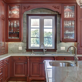 Kitchen - traditional kitchen idea in Toronto with a double-bowl sink, raised-panel cabinets, dark wood cabinets, green backsplash and marble backsplash