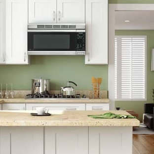 Large traditional eat-in kitchen appliance - Large elegant l-shaped eat-in kitchen photo in Boston with a double-bowl sink, raised-panel cabinets, medium tone wood cabinets, granite countertops, brown backsplash, ceramic backsplash, stainless steel appliances and an island