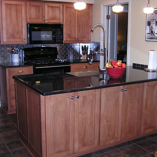 Inspiration for a small timeless galley porcelain floor and brown floor eat-in kitchen remodel