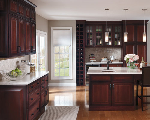 example of a classic kitchen design in other with raisedpanel cabinets dark wood