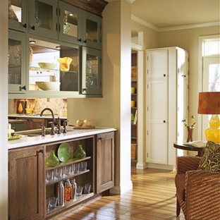 Design ideas for a traditional single-wall kitchen/diner in Orange County with dark wood cabinets, beige splashback, ceramic splashback, medium hardwood flooring and multiple islands.