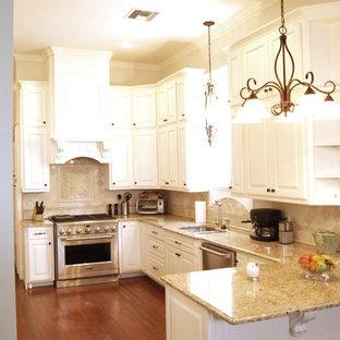 Traditional kitchen designs - Elegant kitchen photo in New Orleans with stainless steel appliances and travertine backsplash