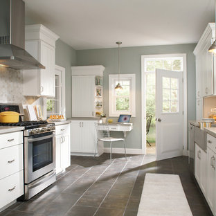 Design ideas for a medium sized traditional u-shaped enclosed kitchen in Other with a belfast sink, louvered cabinets, white cabinets, soapstone worktops, beige splashback, ceramic splashback, stainless steel appliances, ceramic flooring, no island and grey floors.