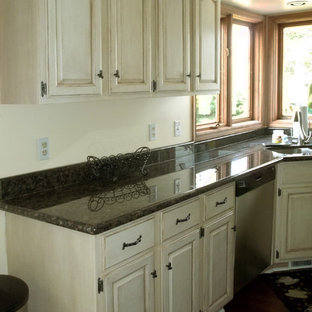 Large shabby-chic style galley kitchen pantry in Cleveland with a double-bowl sink, recessed-panel cabinets, medium wood cabinets, granite benchtops, black appliances, dark hardwood floors and with island.