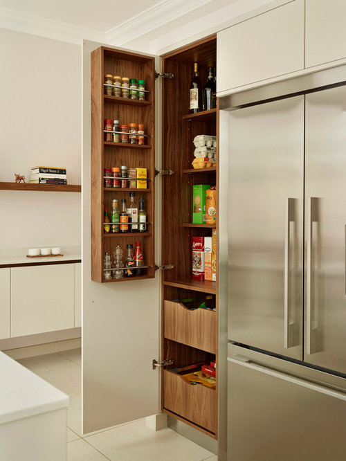 Photo Of A Large Modern Kitchen Pantry In London With Flat Panel Cabinets,  White