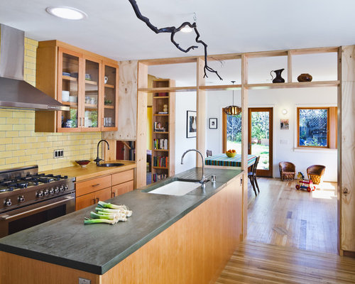 Kitchen   Contemporary Kitchen Idea In San Francisco With Glass Front  Cabinets, Concrete Countertops