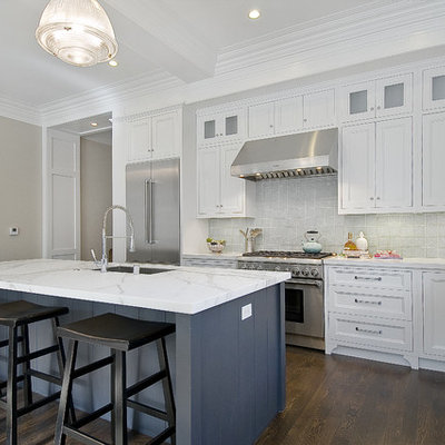 Inspiration for a timeless kitchen remodel in San Francisco with recessed-panel cabinets, stainless steel appliances, white cabinets, marble countertops and gray countertops