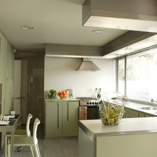 Modern kitchen ideas - Kitchen - modern kitchen idea in Other with laminate countertops, flat-panel cabinets and green cabinets