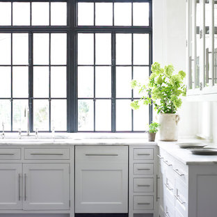 Example of a transitional kitchen design in Atlanta with recessed-panel cabinets and white cabinets