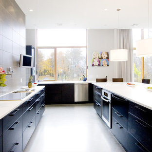 Trendy kitchen photo in Boston with stainless steel appliances, flat-panel cabinets and black cabinets