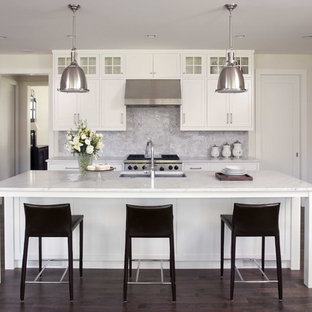 Traditional kitchen designs - Kitchen - traditional dark wood floor kitchen idea in Minneapolis with marble countertops, white cabinets, stone tile backsplash, stainless steel appliances, an undermount sink, recessed-panel cabinets and gray backsplash