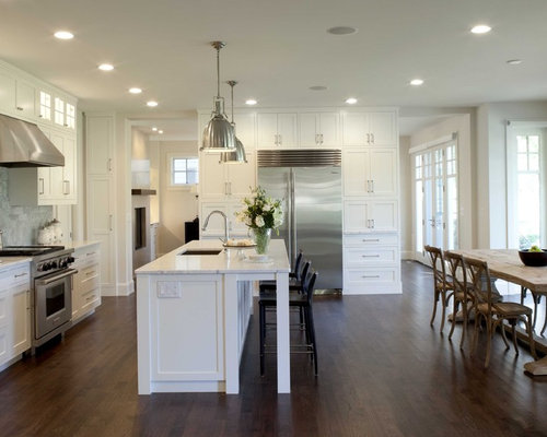 example of a classic dark wood floor eat in kitchen design in minneapolis with stainless - Lights Over Island In Kitchen