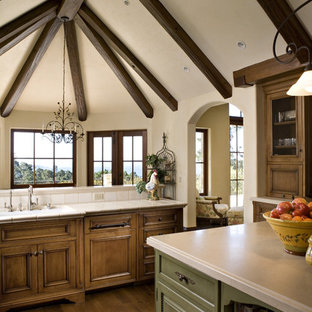 Rustic kitchen in Other with green cabinets.