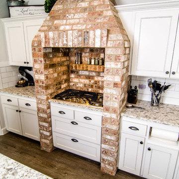 Kitchen - Closer look at brick range / hood