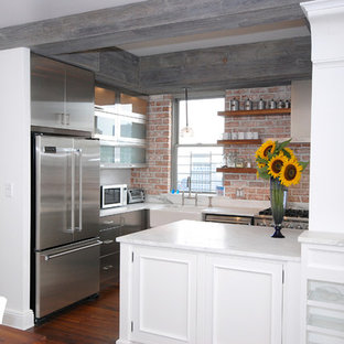 Design ideas for a large contemporary u-shaped kitchen pantry in New York with a built-in sink, flat-panel cabinets, stainless steel cabinets, marble worktops, red splashback, stainless steel appliances, dark hardwood flooring and an island.