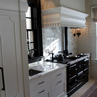 Open concept kitchen - transitional single-wall limestone floor open concept kitchen idea in Toronto with an undermount sink, flat-panel cabinets, white cabinets, marble countertops, white backsplash, stone tile backsplash, black appliances and an island