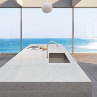 Large modern eat-in kitchen designs - Inspiration for a large modern single-wall eat-in kitchen remodel in New York with a single-bowl sink, gray cabinets, quartz countertops, gray backsplash, stainless steel appliances and an island
