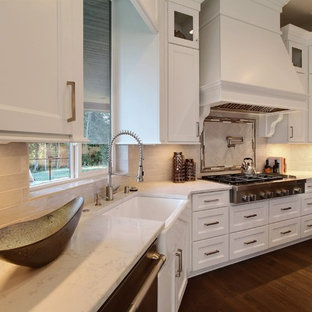 Huge transitional eat-in kitchen inspiration - Huge transitional u-shaped dark wood floor eat-in kitchen photo in Portland with an undermount sink, recessed-panel cabinets, white cabinets, quartzite countertops, white backsplash, ceramic backsplash, stainless steel appliances and two islands