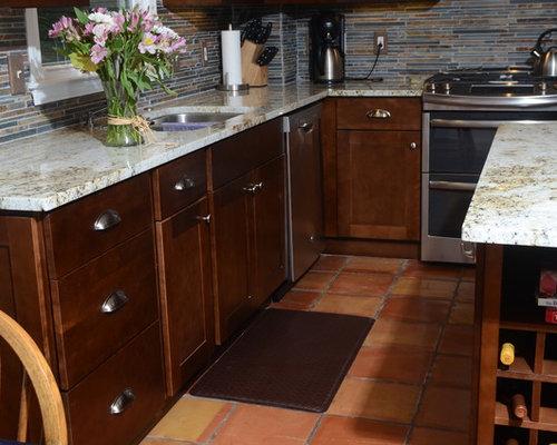 kitchen with mosaic tile backsplash and terra cotta floors