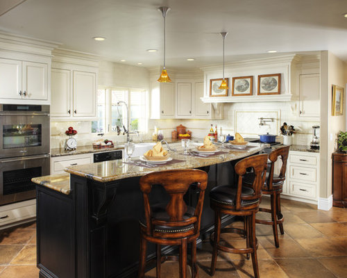 Example Of A Classic L Shaped Kitchen Design In Sacramento With  Recessed Panel Cabinets