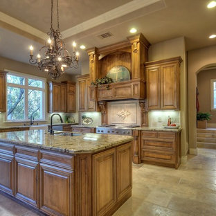 This is an example of a traditional kitchen in Sacramento with granite benchtops, travertine floors and travertine splashback.