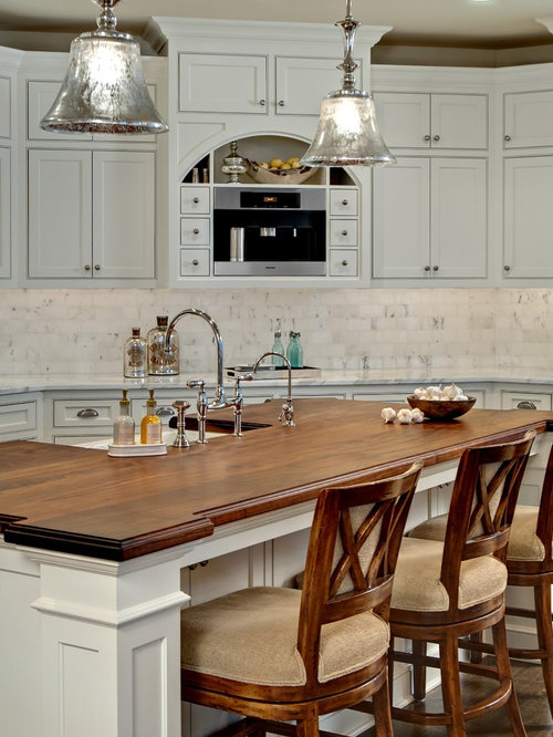 Beautiful Traditional Kitchen Idea In Minneapolis With Wood Countertops