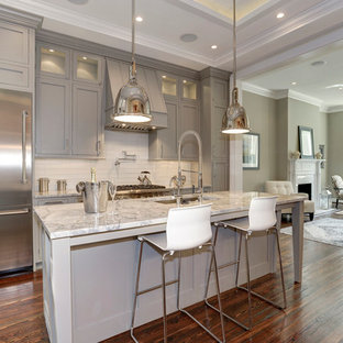 Inspiration for a timeless medium tone wood floor kitchen remodel in DC Metro with an undermount sink, gray cabinets, quartzite countertops and glass tile backsplash