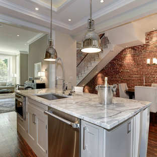 Example of a mid-sized classic medium tone wood floor kitchen design in DC Metro with an undermount sink, gray cabinets, glass tile backsplash, shaker cabinets, granite countertops and an island