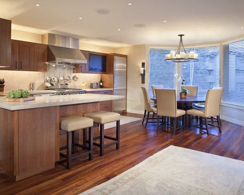 Contemporary l-shaped eat-in kitchen idea in Other with stainless ...