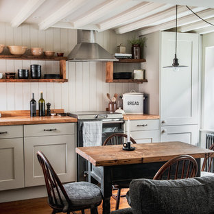 Design ideas for a small rural l-shaped kitchen/diner in Other with a belfast sink, wood worktops, medium hardwood flooring, shaker cabinets, brown floors, brown worktops and exposed beams.