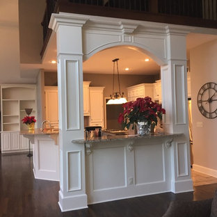 Traditional kitchen remodeling - Inspiration for a timeless kitchen remodel in Kansas City with raised-panel cabinets, white cabinets and stainless steel appliances