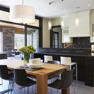 Large modern eat-in kitchen ideas - Inspiration for a large modern single-wall eat-in kitchen remodel in Toronto with glass-front cabinets, multicolored backsplash, mosaic tile backsplash, white cabinets, stainless steel appliances and an island