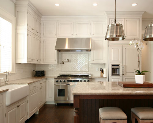 Tile Backsplash And White Cabinets