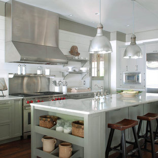 Photo of a traditional kitchen in Atlanta with stainless steel appliances, a farmhouse sink, recessed-panel cabinets, marble benchtops and green cabinets.