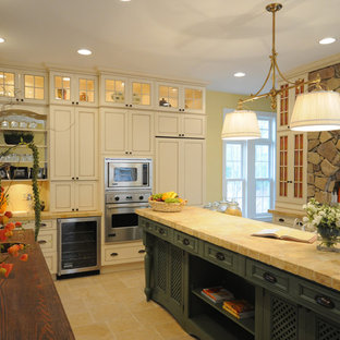 Kitchen - traditional kitchen idea in Other with recessed-panel cabinets, paneled appliances and white cabinets
