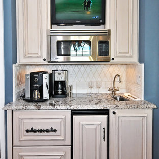 Example of a tuscan kitchen design in Other with granite countertops, raised-panel cabinets and beige cabinets
