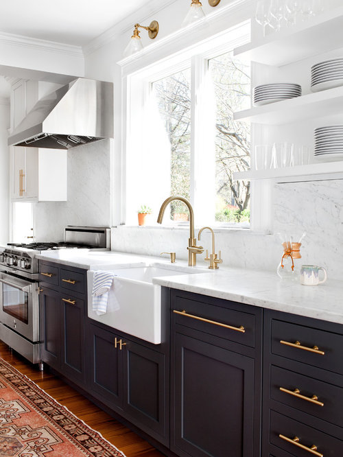 Transitional kitchen appliance - Transitional medium tone wood floor kitchen  photo in Baltimore with a farmhouse