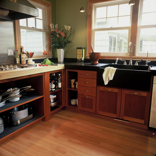 Contemporary Kitchen Idea In Portland With A Farmhouse Sink, Open Cabinets  And Dark Wood Cabinets