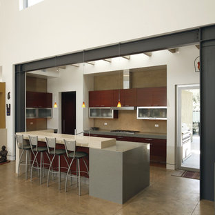 Example of a trendy concrete floor open concept kitchen design in Los Angeles with flat-panel cabinets, dark wood cabinets, quartz countertops and an island