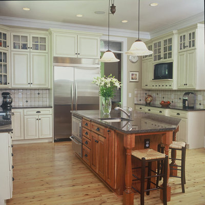 Example of a classic u-shaped kitchen design in Atlanta with raised-panel cabinets, white cabinets, multicolored backsplash and stainless steel appliances