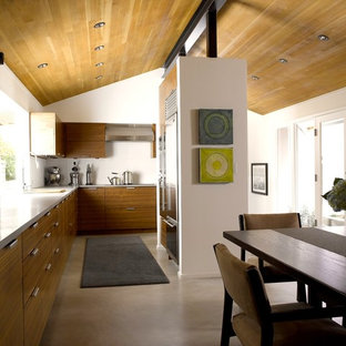 Mid-sized contemporary eat-in kitchen designs - Mid-sized trendy l-shaped concrete floor and gray floor eat-in kitchen photo in Seattle with stainless steel appliances, an undermount sink, flat-panel cabinets, medium tone wood cabinets, concrete countertops, no island and gray countertops