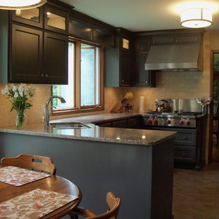 This is an example of a mid-sized traditional u-shaped separate kitchen in Other with a double-bowl sink, shaker cabinets, dark wood cabinets, granite benchtops, beige splashback, stone tile splashback, stainless steel appliances, marble floors, a peninsula, brown floor and grey benchtop.