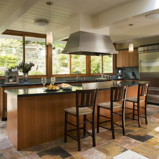 Contemporary kitchen pictures - Trendy multicolored floor kitchen photo in San Francisco with flat-panel cabinets, medium tone wood cabinets, blue backsplash and stainless steel appliances